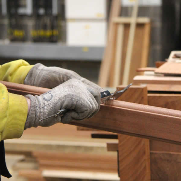 A man working on a bespoke timber window