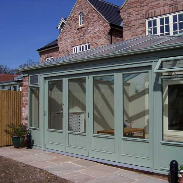 Bifold doors leading from a green conservatory