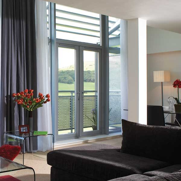 Grey french doors that open onto a balcony