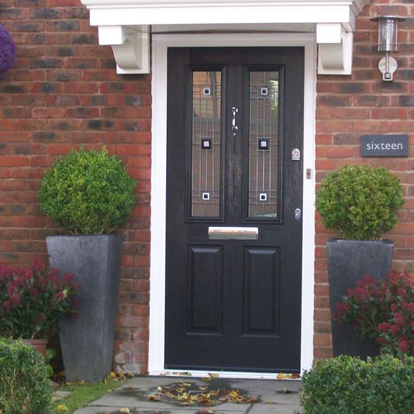 A double glazed composite front door