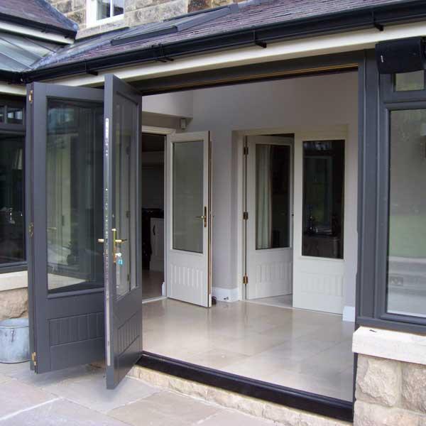 Grey bi folding doors in timber