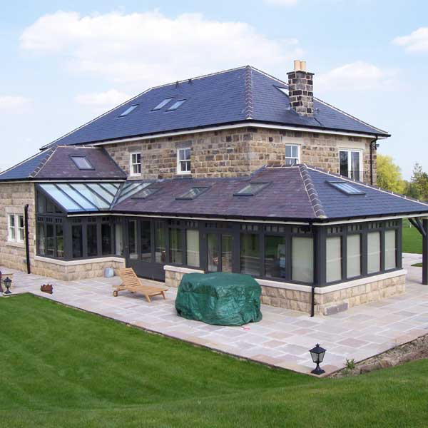 A large timber conservatory used as an extension