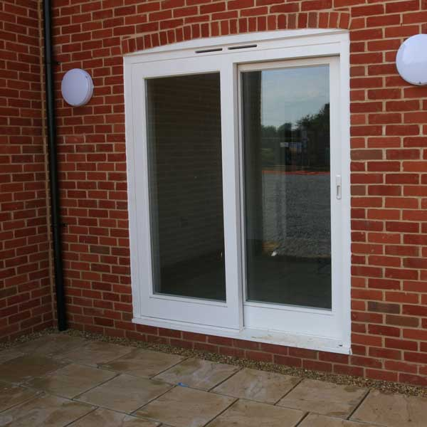 A white timber sliding patio door