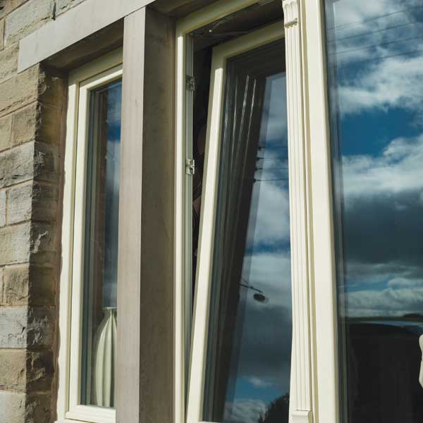 A tilt and turn uPVC window open slightly