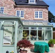 Timber conservatory in chartwell green