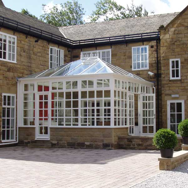 A white timber conservatory with georgian bars