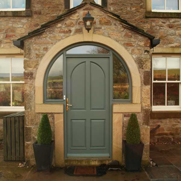 Timber entrance door installed on a traditional property