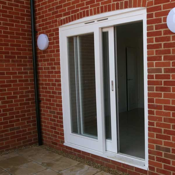 A sliding patio door in white