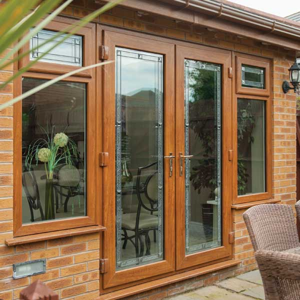 Windows and doors timber effect beaumont inspire for Wood effect upvc french doors