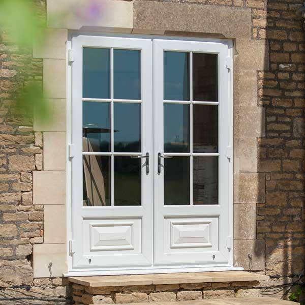 White uPVC french doors leading onto the patio