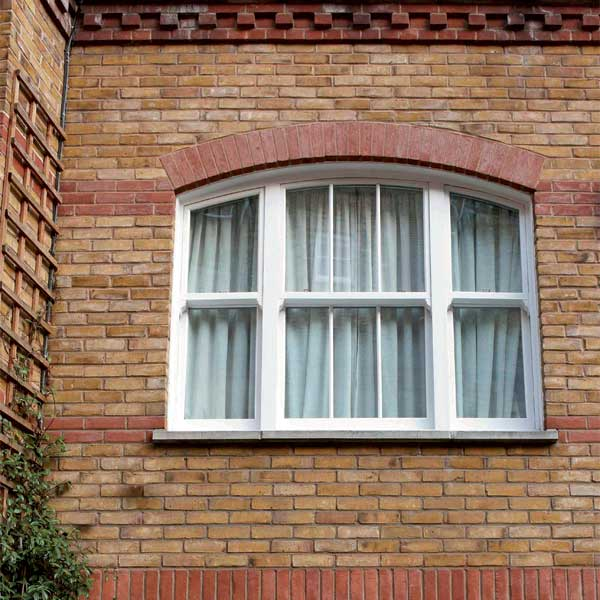 Curved white sash window in uPVC